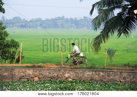 Man Traveling With His Bike Near Alleppey