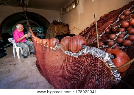 Sciacca, Italy - October 18, 2009: Fisherman In Sciacca, Italy