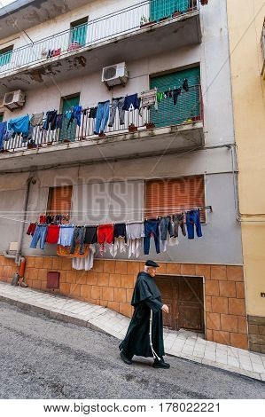 Sciacca, Italy - October 18, 2009: The Priest Crossing The Road In Sciacca, Italy