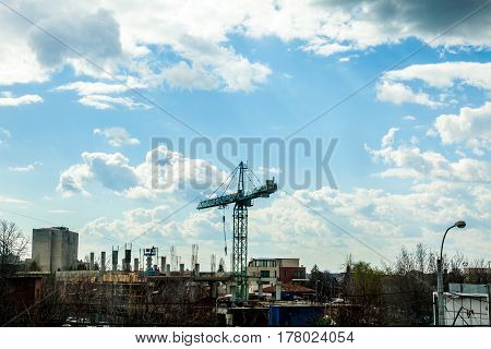 Clouds Over A Construction Yard With A Crane