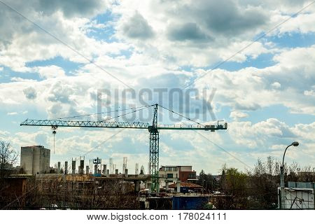 Crane On Industrial Construction Yard In City