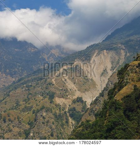 Small village situated close to a big landslide. Scene near Jagat Annapurna Conservation Area Nepal.