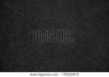 Background of building finishing cement with sand of black color horizontal shot.