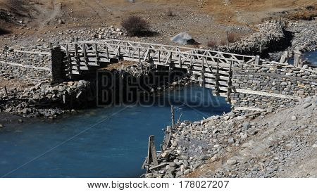 Timber bridge in Manang. Traditional architecture. Scene in Manang Annapurna Conservation Area Nepal.
