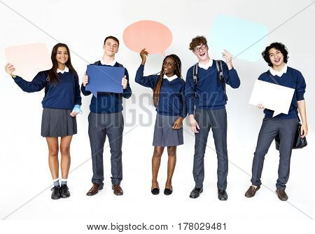 Group of students smiling and holding speech bubble
