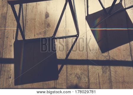 Shadow of chair and wooden plank
