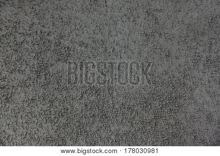 Background of building finishing cement with sand of gray color horizontal image.