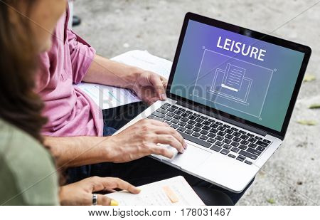 Students using laptop with book icon