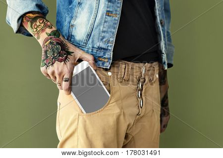 Hand hold smartphone out of the pocket
