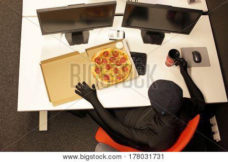 hacker heaving break for pizza - fast meal in office