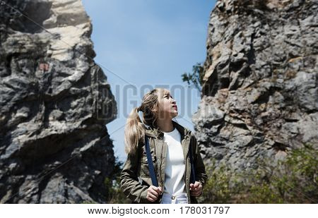 Adult Asian Woman Standing on the Rock Hill