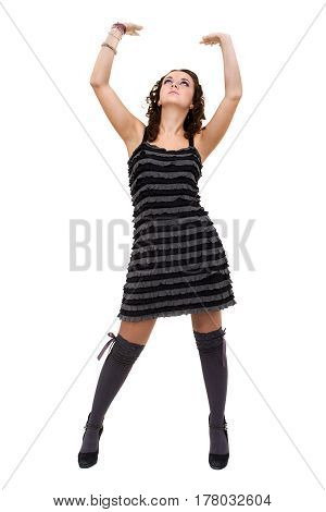 Sexy young woman in a little dress, isolated on white background in full length.