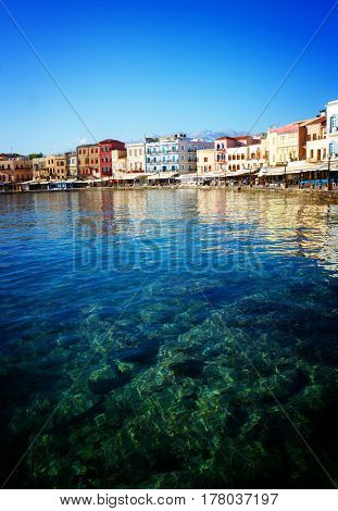 clear turqiouse water of Chania habour, Crete, Greece, retro toned