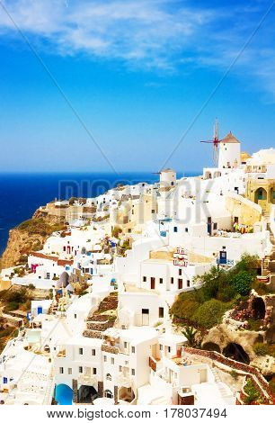 Oia, famous white greek village of Santorini, Greece, retro toned