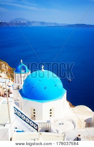 traditional blue dome of church with bellfry, Oia, Santorini, retro toned