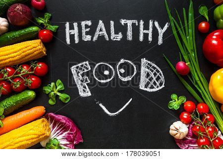 Photo of a table top full of fresh vegetables or healthy food background. Healthy food concept with fresh vegetables for cooking. Title