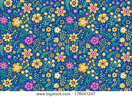 Floral pattern. Pretty flowers on dark blue backgroung. Printing with Small-scale colorful flowers. Ditsy print. Seamless vector texture. Spring bouquet.