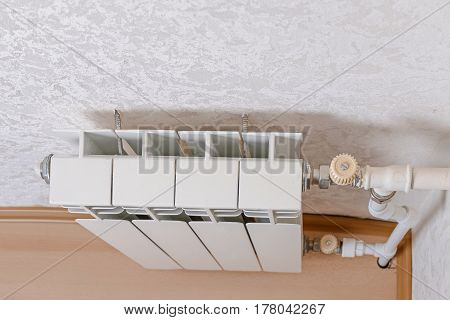 Modern hot water radiator top view with in and out valves