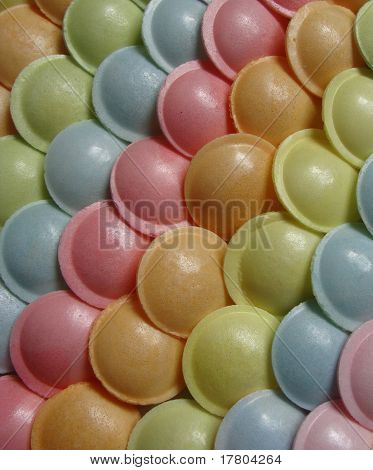 ufo shaped candy sweet in different colors poster