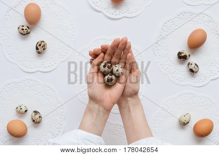 Woman Holding Quail Eggs in Palm of Hands