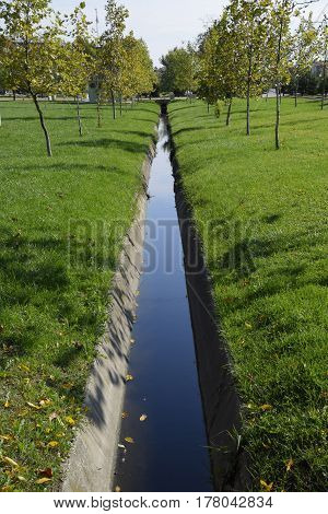 Drain Drain For Water. Autumn In The Park. Park In A Small Village. Autumn Colors