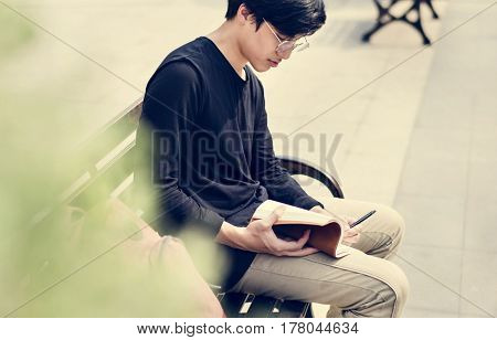 Asian man reading book relaxation
