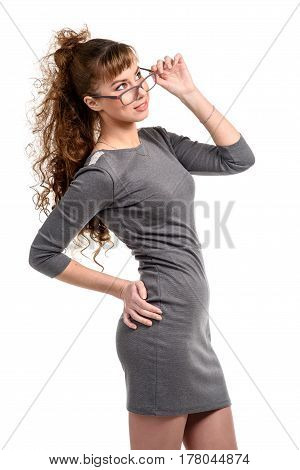 Thoughtful cheerful woman touching her glasses isolated on white.