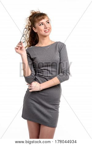 Cheerful young woman with glasses isolated on white.