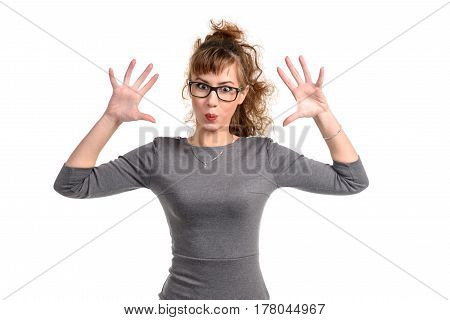 Cheerful woman with the hands up grimacing at camera isolated on white.