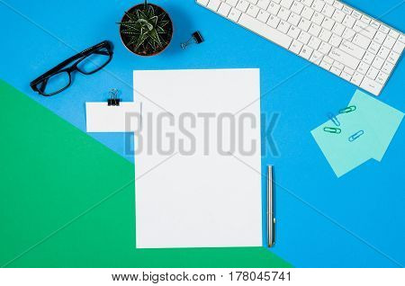 Mock-up magazine or catalog on colorful table. White page or notepad on modern background. Blank copy space for mockups or simulations.