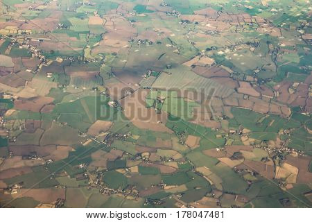 Small city and  Farm landscape with some clouds made from airplane illuminator