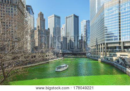 CHICAGO, ILLINOIS - 15 March 2014 - Dying the Chicago River green on Saint Patrick Day set against the famous Chicago architecture.