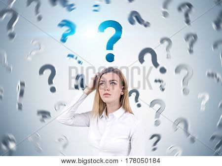Woman Scratching Head And Question Marks