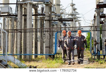 Working with a tool in the hands against the background of power plant