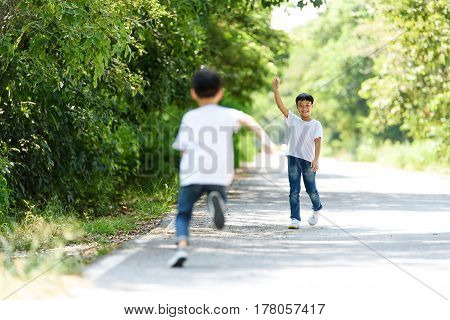 Two Boy Run In The Park