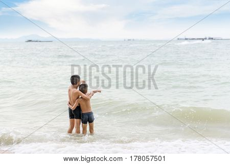 Young Asian Thai Boy Playing On The Sand Beach