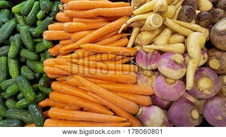 variety of root vegetable with cucumbers sold at the market