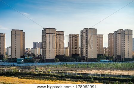 Beijing, China - Oct 31, 2016: Newly constructed residential high-rise apartments. Scene captured from within a High-Speed Rail (HSR) bullet train traveling at 300 km/h.