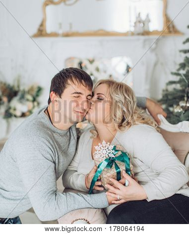 Happy husband and wife in Christmas decorations