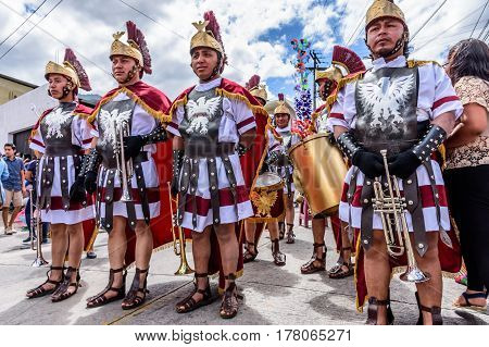 Antigua, Guatemala - March 5 2017: Locals dressed as Romans signal approach of Lent procession in colonial town with most famous Holy Week celebrations in Latin America.