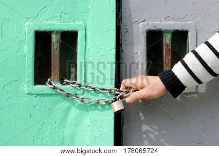 Old metal door with chain key lock