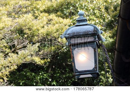 Dirty old light lantern with roof closeup