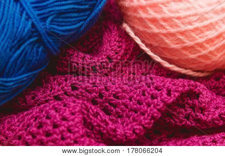 Authentic hanks of bright yarn for knitting on a braight background with copyspace.