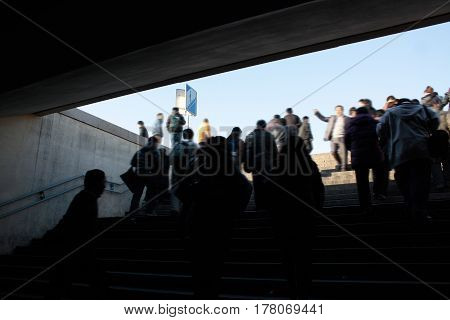 People walking up stairs from underground train station.Low speed shutter .Motion blur .