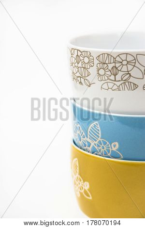Stack or collection of ceramic bowls floral ornament pastel colors styled image for social media blogging banner header copyspace for announcements