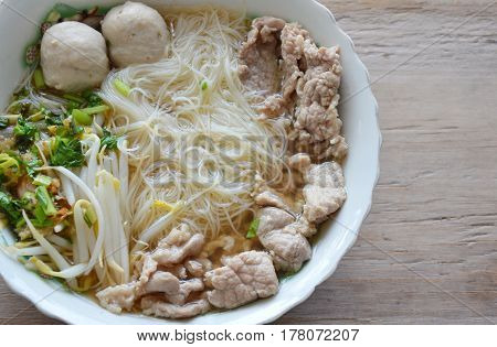thin rice noodle with pork ball in soup on bowl