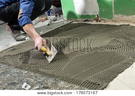 Construction Worker Applying Ceramic Glue