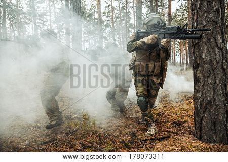 Norwegian Rapid reaction special forces FSK soldiers in field uniforms in action in the forest fog