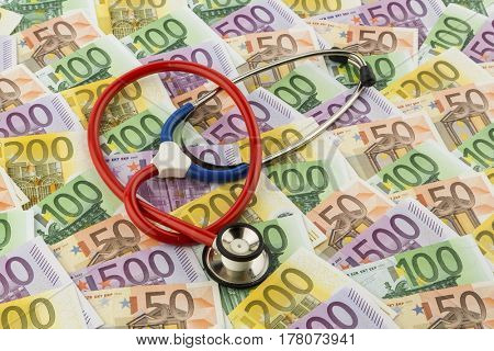 stethoscope and euro banknotes