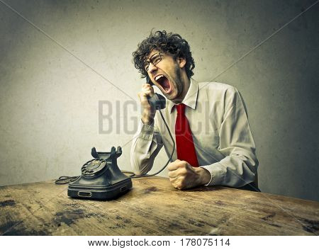 Businessman screaming on the telephone